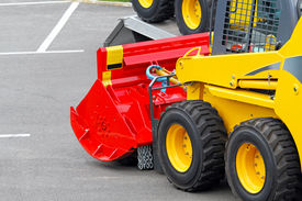 stock photo of skid-steer  - Skid steer construction machine with interchangeable attachment - JPG