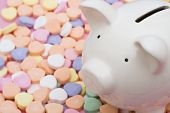 picture of save money  - Piggy bank on candy hearts  - JPG