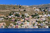 Sightseeing Of Greece. The Picturesque Coastline Of Symi Island With Beautiful Old Houses, Symi Isla poster