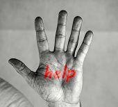 Men`s Palm With A Help Red Inscription. Man Holds Palm In Front Of Him. He Has An Inscription Help O poster