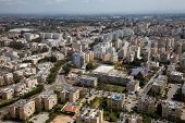 Aerial View Of A Residential Neighborhood In A City During A Cloudy And Sunny Day. Taken In Netanya, poster