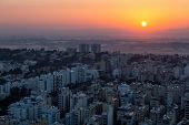 Aerial View Of A Residential Neighborhood In A City During A Vibrant And Colorful Sunrise. Taken In  poster