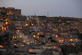 Amazing Lighted Buildings In Ancient Sassi District By Night In Matera, Well-known For Their Ancient poster