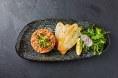 Salad, Meat And Sliced Long Loaf Slices, Lie On A Black Plate poster