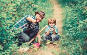Day Of Earth. Boy And Father In Nature. Gardening Tools. Planting Flowers. Dad Teaching Little Son C poster