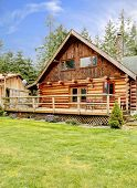 Rustic Log Small Cabin Deck Exterior.