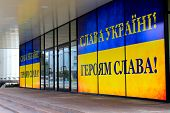 Yellow Blue Banner As The Ukrainian Flag With The Slogan In Ukrainian - Glory To Ukraine! Glory To H poster