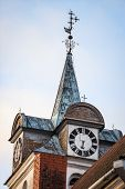 Beautiful Old Church Tower With Clock. Old Building With Cloudy Overcast Background. Photo Taken On  poster