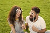 Fun Ideas. Funny Couple In Love Relaxing On Green Grass. Happy Couple Having Fun With Prop Glasses O poster
