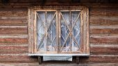 A Small Wooden Window Of A Traditional Old House. The Window Is Closed And Brown. An Old Window With poster