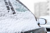Car Mirror In The Snow Close-up. Side Mirror Of Vehicle. Car Standing In Snow. Snowdrift Snow By Veh poster