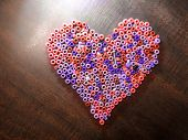 Plastic Pony Craft Beads In The Shape Of A Heart poster