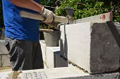 Bricklayer Builder Laying Autoclaved Aerated Concrete Blocks, Aac For New House Wall.  Autoclaved Ae poster