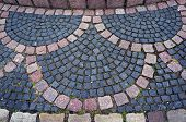 Pattern of stone pavement in Bodenwerder, Germany. poster