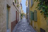 2_ One Of The Many Colourful And Quiet Streets In Antibes, France. poster