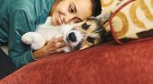 Portrait Of Young Smiling Woman Hugging Pet. Cute Welsh Corgi Puppy Resting With Owner, Spending Tim poster