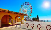 Entrance in amusement park at Mount Tibidabo Barcelona Spain with Ferris wheel attraction. Ticket of poster