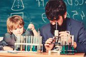Back To School. Student Doing Science Experiments With Microscope In Lab. Father And Son At School.  poster