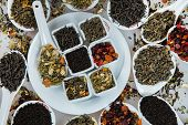 Assortment Of Dry Tea. Various Kinds Of Tea Isolated On White.different Kinds Of Tea Leaves. Tea Com poster
