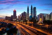 Kuala Lumpur City Skyscraper And Highway Street With Nice Sky Sunrise At Downtown Business District  poster