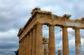 Close-up View Of Ruins Of Famous Ancient Greek Temple Of Parthenon Against Cloudy Sky. Famous Touris poster