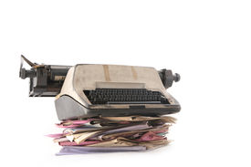 picture of old vintage typewriter  - Isolated stack of folders with a typewriter shot over white background - JPG