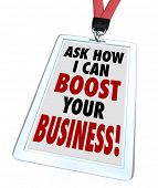 The words Ask Me How I Can Boost Your Business on a badge to advertise a service to improve your com