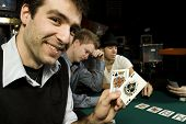 Young Poker Player Holding Winning Hand