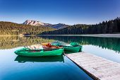 Reflection in water of mountain lakes and boats. Black lake in Durmitor national park in Montenegro,