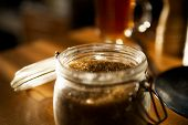 image of scruple  - glass jar filled with brown cane sugar - JPG