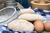 Panini Rolls In Rustic Kitchen Setting With Cooking Utensils