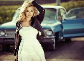 picture of driving  - Young woman driving vintage car - JPG