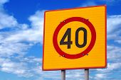 stock photo of square mile  - Speed limit road sign above blue cloudy sky - JPG