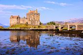 picture of british culture  - Famous Eilean Donan Castle in the highlands of Scotland with reflections - JPG