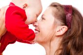 stock photo of happy baby boy  - Portrat of laughing mother and baby in red - JPG