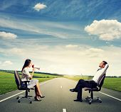 stock photo of angry smiley  - smiley man and angry woman on the road - JPG