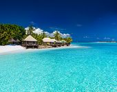 pic of beach hut  - Beach Villas on small tropical island with palm trees - JPG