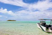 stock photo of breathtaking  - picture perfect view at the island breathtaking lagoon and anchored boat at cook islands aitutaki - JPG