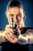 image of terrorist  - Dangerous woman terrorist dressed in black with a gun in her hands - JPG