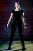 picture of terrorist  - Dangerous woman terrorist dressed in black with a gun in her hands - JPG