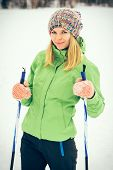 image of nordic skiing  - Young Woman with ski happy smiling face winter time snow Skiing Sport and healthy Lifestyle concept - JPG