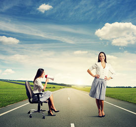 picture of angry smiley  - angry woman and smiley calm woman on the road - JPG