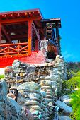 foto of water-mill  - Old syle house with water mill on the blue sky background - JPG