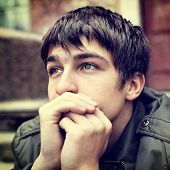 stock photo of sad  - Toned photo of sad Teenager Portrait outdoor