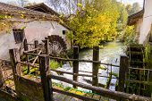 image of water-mill  - The shovels of an old water mill now in disuse - JPG