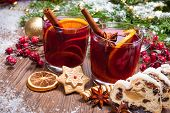 stock photo of punch  - Two glasses of mulled wine with christmas decoration - JPG