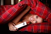 stock photo of peek  - Beautiful Young Woman Peeking Out Of The Blanket with a jewelry box  - JPG