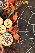 stock photo of spiderwebs  - Different sweets for Halloween party on dark background with spiderweb - JPG