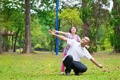 stock photo of southeast asian  - Father and daughter playing at outdoor garden park - JPG