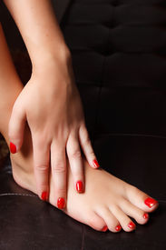 stock photo of painted toes  - Painted Nails And Toes With Red Nail Polish - JPG